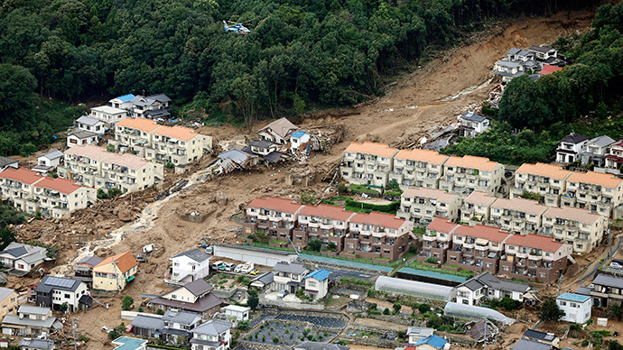 An aerial view shows a landslide that swept through a residential area at Asaminami ward in Hiroshima, western Japan, in this photo taken by Kyodo August 20, 2014. (Reuters / Kyodo)