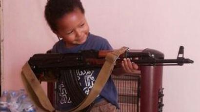 Image from twitter.com @Ash_Shamiyyah shows the son of ISIS jihadi, Khadijah Dare, holding an AK 47.