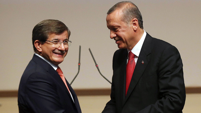Turkey's president-elect Recep Tayyip Erdogan (R) shakes hands with Turkey's Foreign Minister Ahmet Davutoglu after he announced Davutoglu as new chairman of his ruling Justice and Development Party (AKP) and new Turkish prime minister in Ankara on August 21, 2014. (AFP Photo / Adem Altan)