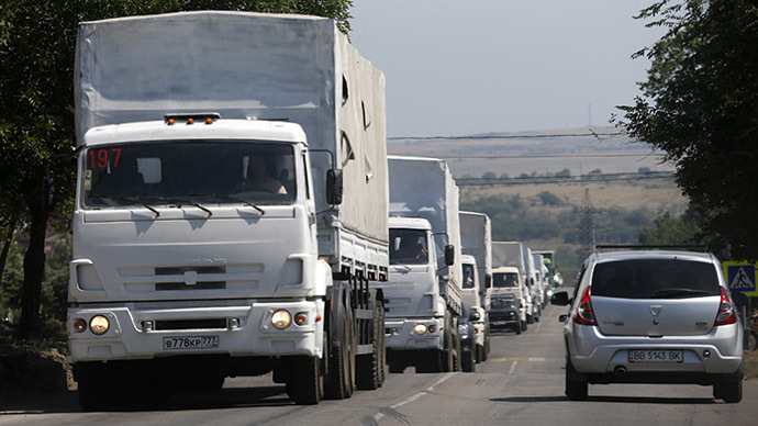 Trucks of a Russian convoy carrying humanitarian aid for Ukraine, drive in the direction of the Ukrainian border near the town of Donetsk, in Russia's Rostov Region, August 22, 2014. (Reuters / Alexander Demianchuk)