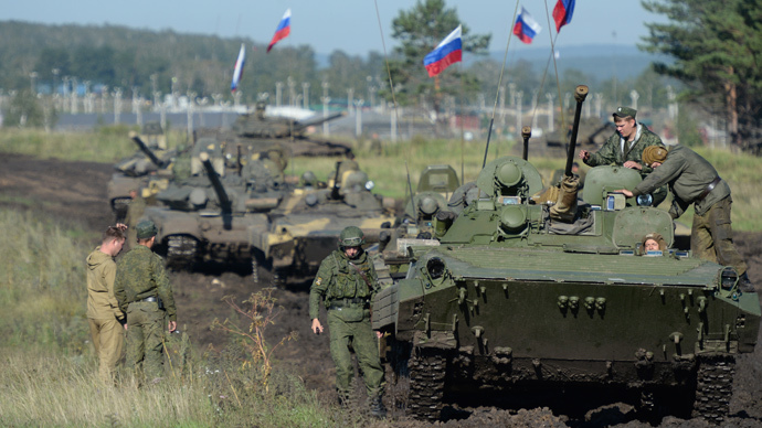 ARCHIVE PHOTO: The column of Russian BMP-2 during the joint Russian-Chinese exerciseы Peace Mission 2013 at the Chebarkul training ground in the Chelyabinsk region. (RIA Novosti / Pavel Lisitsyn)
