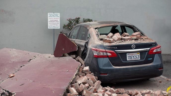 A car damaged by bricks falling during an earthquake is seen next to a downtown building in Napa, California August 24, 2014.(Reuters / Stephen Lam)