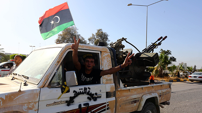 Islamist fighters after capturing the Tripoli international airport on August 24, 2014 (AFP Photo / Mahmud Turkia)