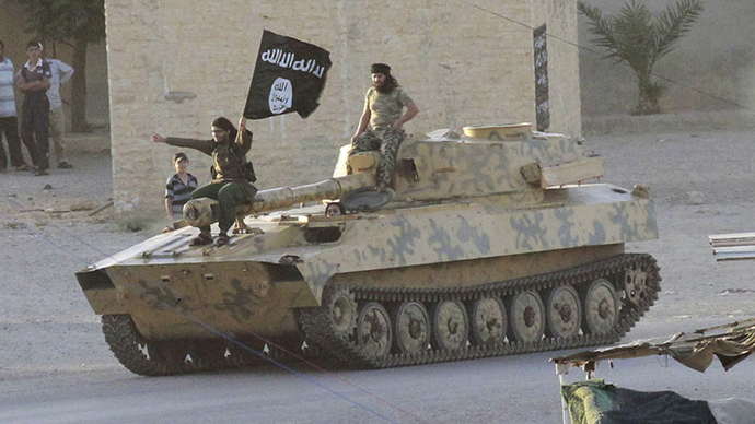 Islamist fighters taking part in a military parade along the streets of Syria's northern Raqqa province June 30, 2014. (Reuters)