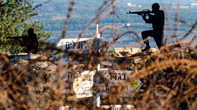 Sculptures of Israeli soldiers standing guard is seen next to a sign for tourists showing the different distances to various cities (unseen), at an army post in Mount Bental in the annexed Golan Heights, on August 28, 2014.(AFP Photo / Jack Guez)