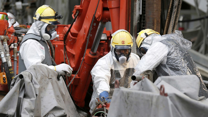 Workers conduct operations to construct an underground ice wall at Tokyo Electric Power Co.'s (Tepco) tsunami-crippled Fukushima Daiichi nuclear power plant in Fukushima Prefecture July 9, 2014. (Reuters)