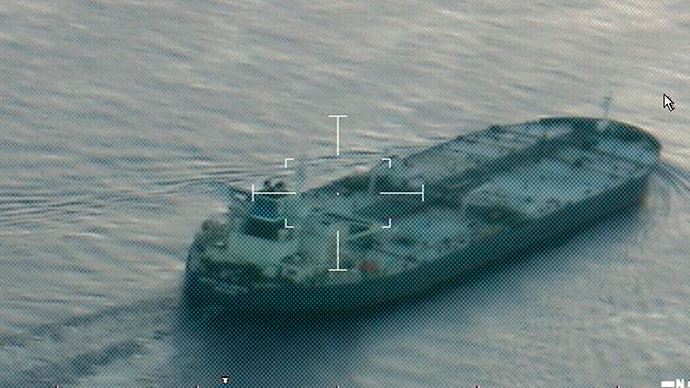 A still image from video taken by a U.S. Coast Guard HC-144 Ocean Sentry aircraft shows the oil tanker United Kalavyrta (also known as the United Kalavrvta), which is carrying a cargo of Kurdish crude oil, approaching Galveston, Texas July 25, 2014 (Reuters / US Coast Guard)