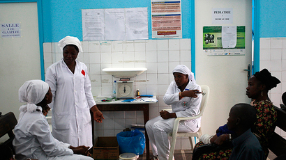 Nurses talk near a poster (C) displaying a government message against Ebola, at a maternity hospital in Abidjan (Reuters / Luc Gnago)