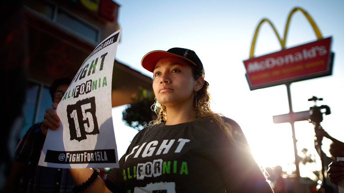 Demonstrators take part in a protest to demand higher wages for fast-food workers outside McDonald's in Los Angeles, California May 15, 2014.(Reuters / Lucy Nicholson)