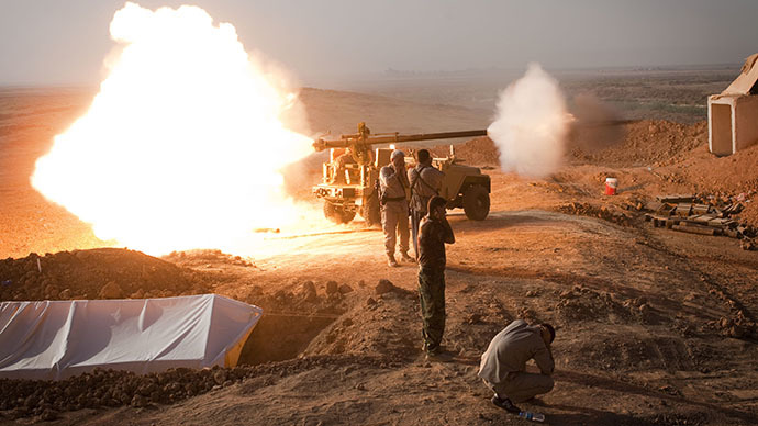 Iraqi Kurdish Peshmerga fighters fire a recoilless rifle towards Islamic State (IS) positions during heavy clashes in Tuz Khurmatu in Salaheddin province about  88 kilometres (55 miles) south of Kirkuk on August 31, 2014. (AFP Photo / Jm Lopez)