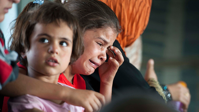 A child cries in a military helicopter after being evacuated by Iraqi forces from Amerli, north of Baghdad August 29, 2014 (Reuters / Stringer)