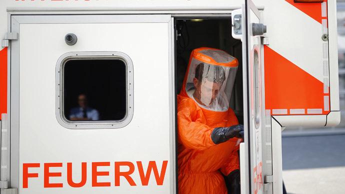 ebola-marshal-syringe-airport.si.jpg