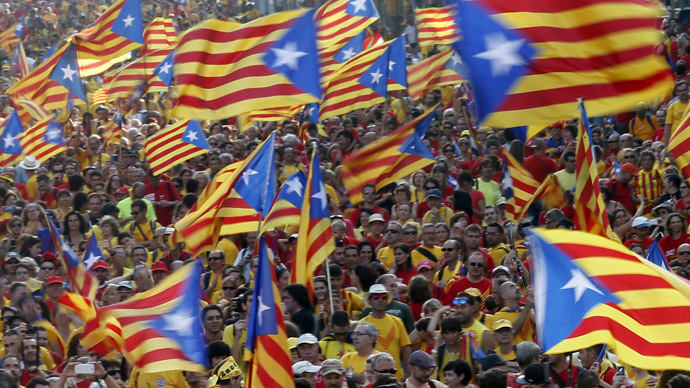 "People hold ""estelada"" flags, Catalan separatist flags, as they form a ""V"" for ""vote"" during a gathering to mark the Calatalonia day ""Diada"" in central Barcelona September 11, 2014. (Reuters/Albert Gea)"