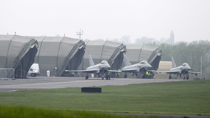 Typhoon jets taxi to their hangers at RAF Northolt in west London May 2, 2012. (Reuters/Paul Hackett)
