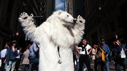 """A protestor dressed as a polar bear dances in the streets during the """"Flood Wall Street"""" protest on September 22, 2014 in New York City. (AFP Photo/Bryan Thomas)"""