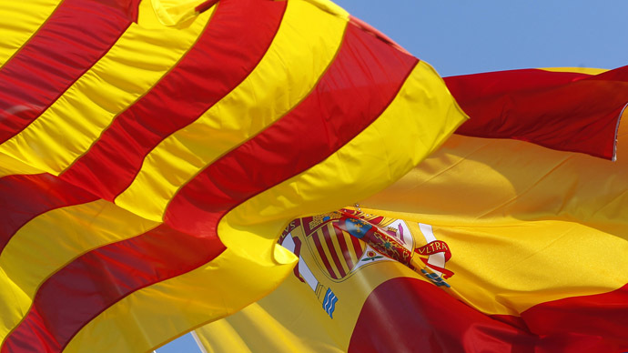 Flags of Catalunya (L) and Spain (R). (Reuters/Albert Gea)