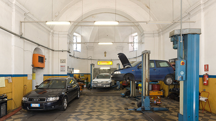 Madonna della Neve church in Como, Italy was turned into a successful car repair shop by the building's new owners. (Photo by Di Martino)