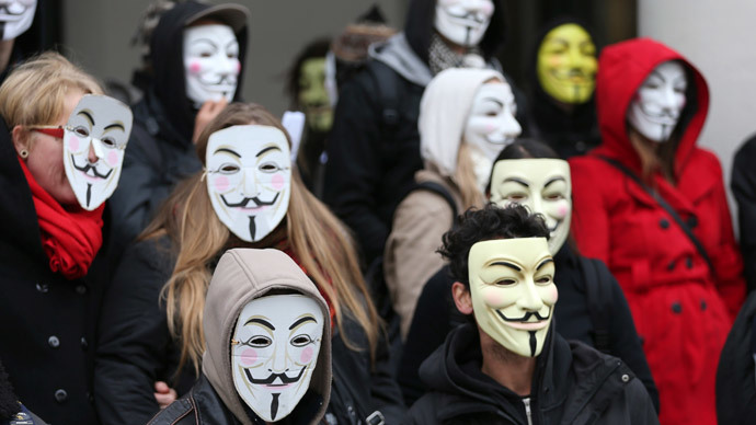 Pro-democracy protesters wearing Guy Fawkes masks pose in central Brussels November 5, 2014, on the day marking Guy Fawkes Night.(Reuters/  Francois Lenoir)