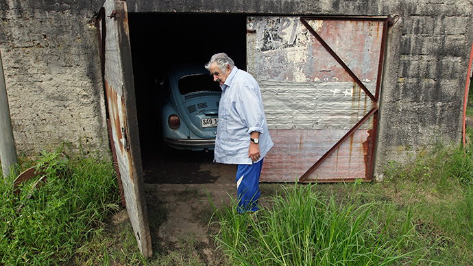 Uruguay's President Jose Mujica walks in front of his garage (Reuters / Andres Stapff)