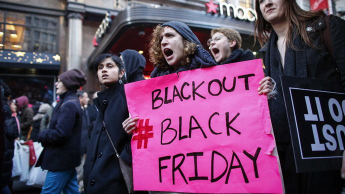Protesters march outside Macy's store during the Black Friday protest on November 28, 2014 in New York. (AFP Photo/Kena Betancur)