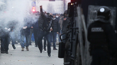 An anti-government protester throws a stone to the police during a demonstration in central Pristina January  27, 2015. (Reuters/Hazir Reka)