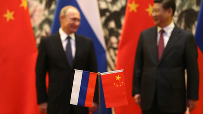 Russian President Vladimir Putin (L) and his Chinese counterpart Xi Jinping.(Reuters / How Hwee Yong)