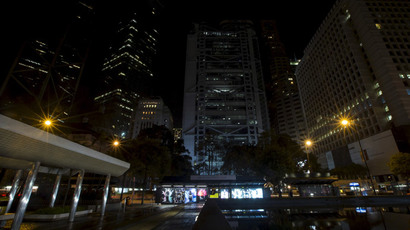 Hong Kong's central financial district's (L-R) Bank of China Tower, Cheung Kong Centre, HSBC headquarters and Standard Chartered Bank are pictured with most of their lights switched off during Earth Hour March 28, 2015.(Reuters / Tyrone Siu)