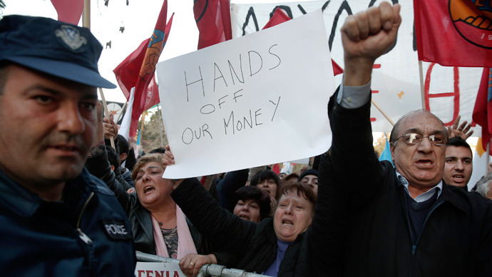 Protesters shout slogans during an anti-bailout rally outside the parliament in Nicosia March 19, 2013 (Reuters / Yorgos Karahalis)
