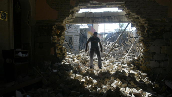An Iraqi man inspects damages at the Mar Afram Syriac Orthodox Church following an explosion in the northern city of Kirkuk on August 15, 2011 as a series of nationwide attacks hit the country (AFP Photo / Marwan Ibrahim)