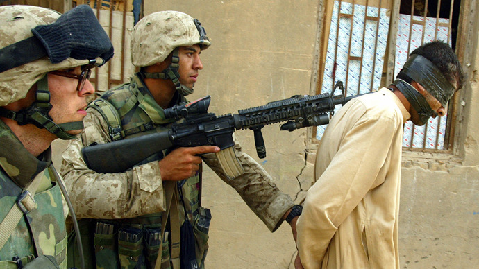 US marines from the 3/5 Lima company arrest a man while conducting a house-to-house search in the Jolan district of the restive city of Fallujah 12 November 2004, 50 kms west of Baghdad (AFP Photo / Patrick Baz)