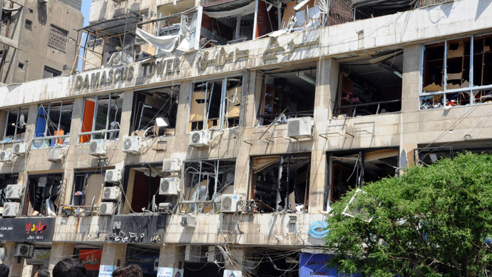 A handout picture released by the Syrian Arab News Agency (SANA) on April 30, 2013, shows the damaged frontage of a building caught in a blast in the Marjeh district of Damascus. (AFP/SANA)