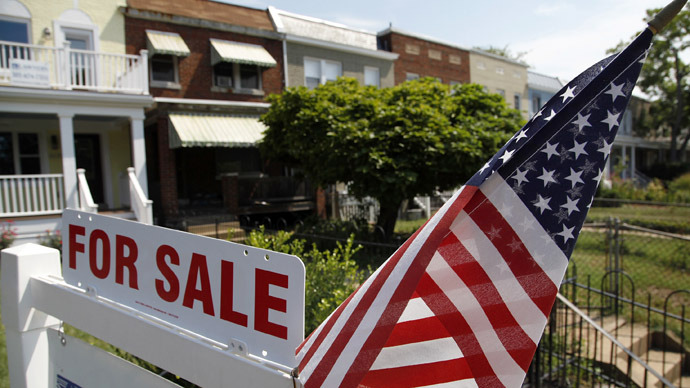 A U.S. flag decorates a for-sale sign at a home in the Capitol Hill neighborhood of Washington (Reuters/Jonathan Ernst)