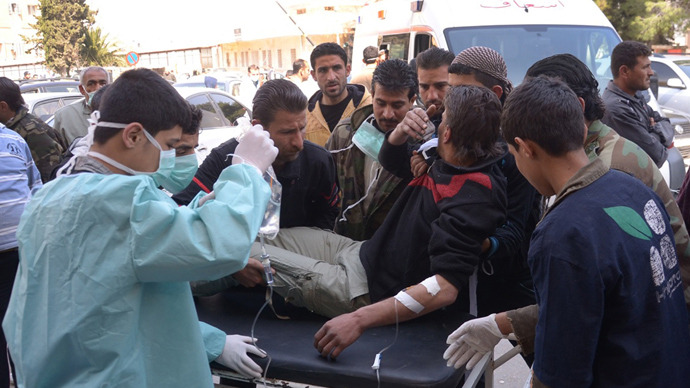 In this image made available by the Syrian News Agency (SANA) on March 19, 2013, a man is brought to a hospital in the Khan al-Assal region in the northern Aleppo province, as Syria's government accused rebel forces of using chemical weapons for the first time (AFP Photo / Sana)
