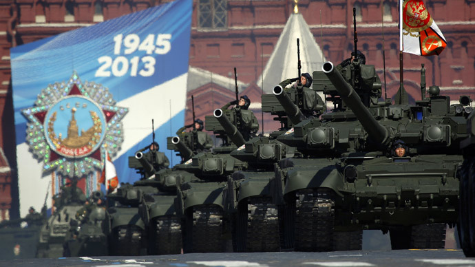 Russian servicemen salute from tanks during the Victory Parade on Moscow's Red Square May 9, 2013. (Reuters/Maxim Shemetov)
