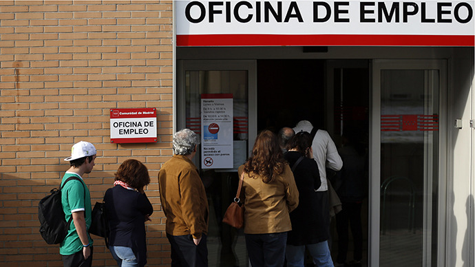 People enter a government-run employment office in Madrid May 6, 2013. (Reuters / Sergio Perez)