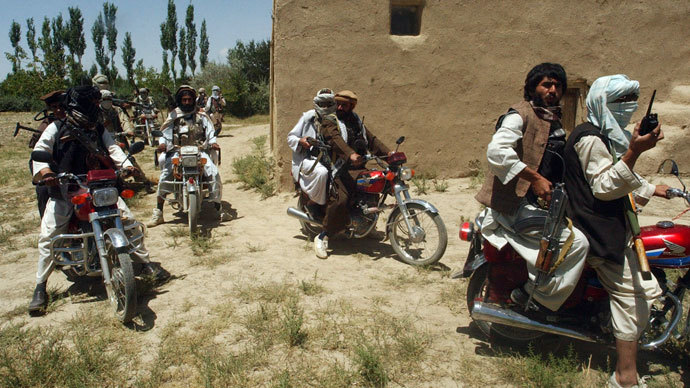 Taliban fighters ride on motorbikes in an undisclosed location in Afghanistan.(Reuters / Stringer)