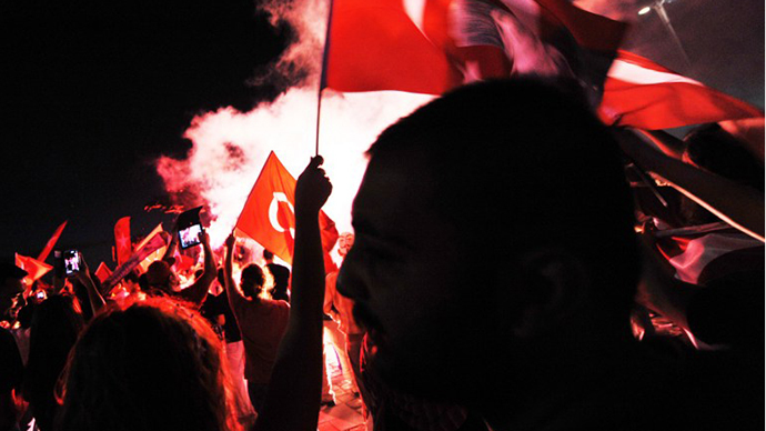 Turkish demonstrators burn flares during a protest on Gundogdu square in Izmir. (AFP Photo / Ozan Kose)