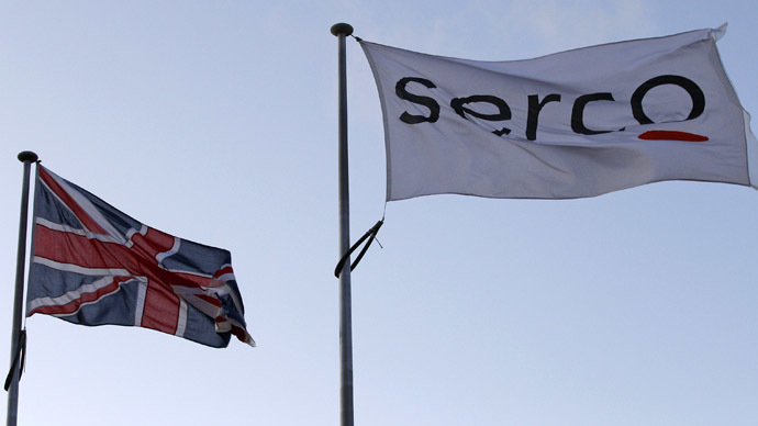 A Serco flag is seen flying alongside a Union flag outside Doncaster Prison in northern England (Reuters/Darren Staples)