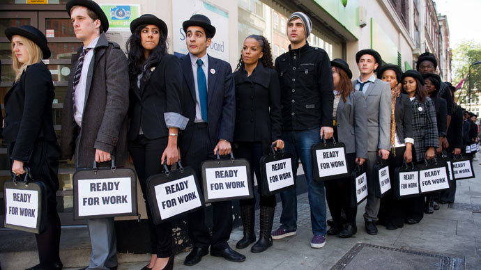 Unemployed young people as they stand in line outside a job centre in central London.(AFP Photo / Leon Neal)