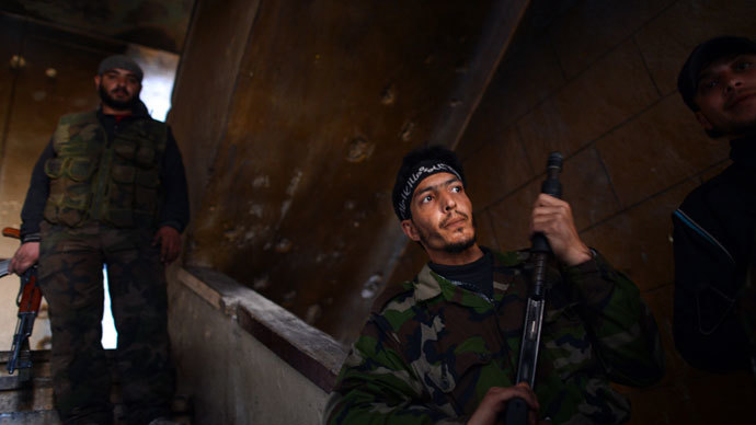 Syrian rebels take position inside a building in the Saif al-Dawla district of the northern Syrian city of Aleppo on April 5, 2013. (AFP Photo / Dimitar Dilkoff)