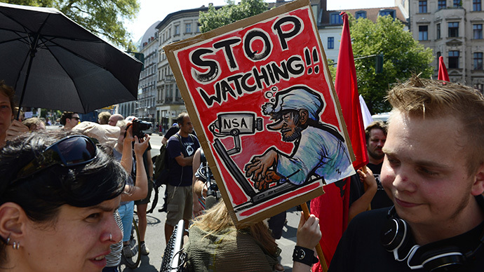 Demonstrators take part in a protest against the US National Security Agency (NSA) collecting German emails, online chats and phone calls and sharing some of it with the country's intelligence services in Berlin on July 27, 2013. (AFP Photo / John Macdougall)