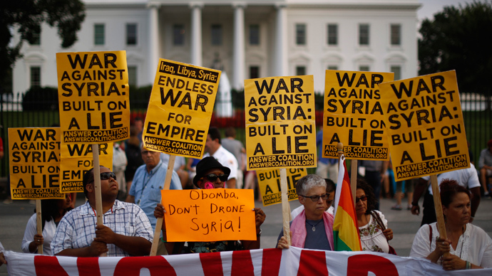 "The ""Act now to stop war and end racism"" (ANSWER) coalition holds a rally outside the White House in Washington, August 29, 2013 (Reuters / Jason Reed)"