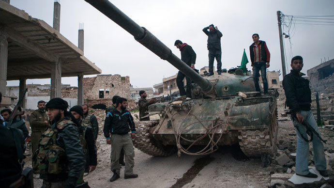 Syrian rebels gather around a T-72 tank.(AFP Photo / Daniel Leal-Olivas)