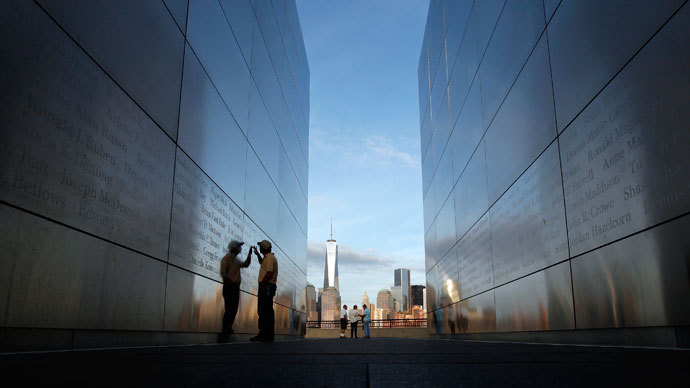 A man touches the wall at the 9-11 Empty Sky memorial across from New York's One World Trade Center at Liberty State Park in Jersey City, New Jersey, September 9, 2013.(Reuters / Gary Hershorn)