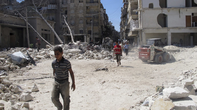 Men walk on rubble of buildings damaged by what activists said was shelling by forces loyal to Syria's President Bashar al-Assad in Aleppo's Bustan al-Qasr district, September 9, 2013. Picture taken September 9, 2013. (Reuters/Abdalghne Karoof)
