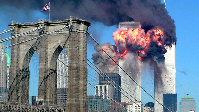 FILE PHOTO - Both towers of the World Trade Center burn after being hit by planes in New York September 11, 2001. (Reuters/Sara K. Schwittek)