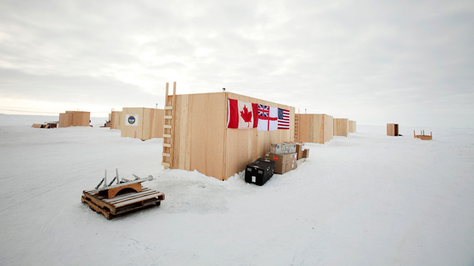Plywood buildings used to house participants have the flags of Canada, the British Royal Navy, and the United states draped on their side at the Applied Physics Lab Ice Station in the Arctic north of Prudhoe Bay, Alaska (Reuters / Lucas Jackson)