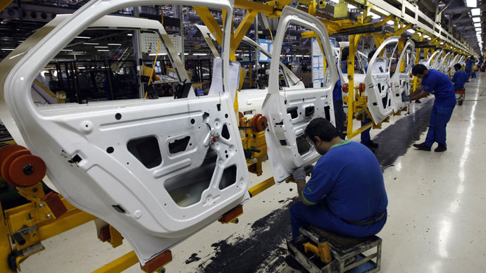 Iranian technicians work on parts for Peugeot 206 cars at the Iran Khodro auto plant, west of Tehran, on September 30, 2008.(AFP Photo / Behrouz Mehri)