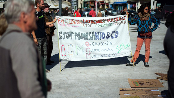 "Anti-genetically modified foods (GMO) protestors demonstrate on October 12, 2013 against US agro-chemicals giant Monsanto in the southern French city of Marseille during a day of worlwide action against the company. Banner reads: ""Organize War Against Monsanto."" (AFP Photo / Bertrand Langlois)"
