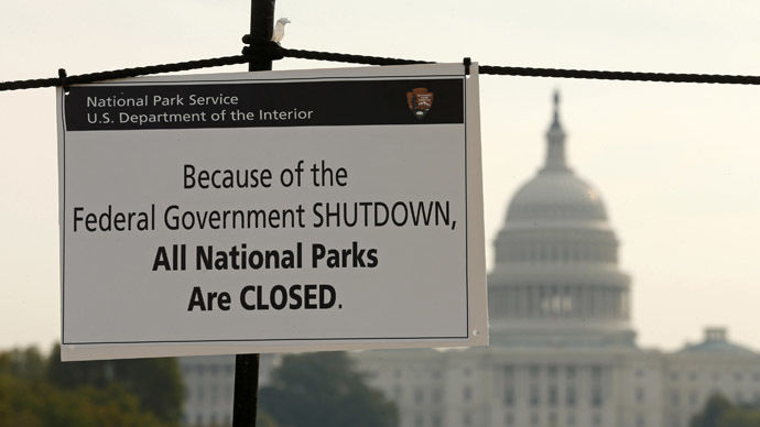 The U.S. Capitol looms in the background of a sign on the National Mall reminding visitors of the closures to all national parks due to the federal government shutdown in Washington October 3, 2013. (Reuters/Kevin Lamarque)